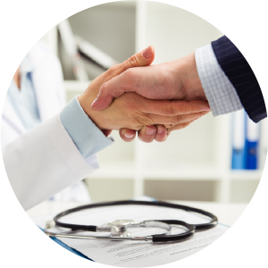 doctor shaking hands with business man
