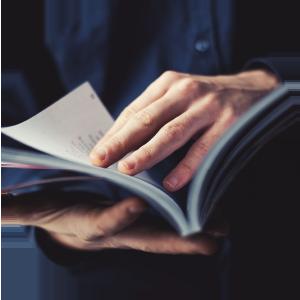 man flipping through medical journal